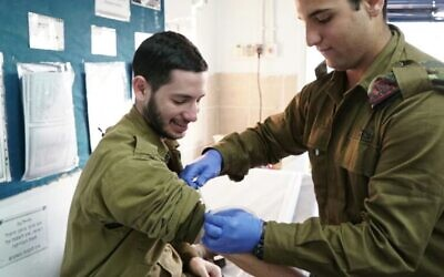 Illustrative: An IDF medic prepares to take blood from a soldier, in an undated photograph. (Israel Defense Forces)