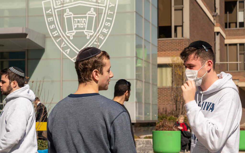 Illustrative: A Yeshiva student wears a face mask on the grounds of the university on March 4, 2020 in New York City. (David Dee Delgado/Getty Images via JTA)