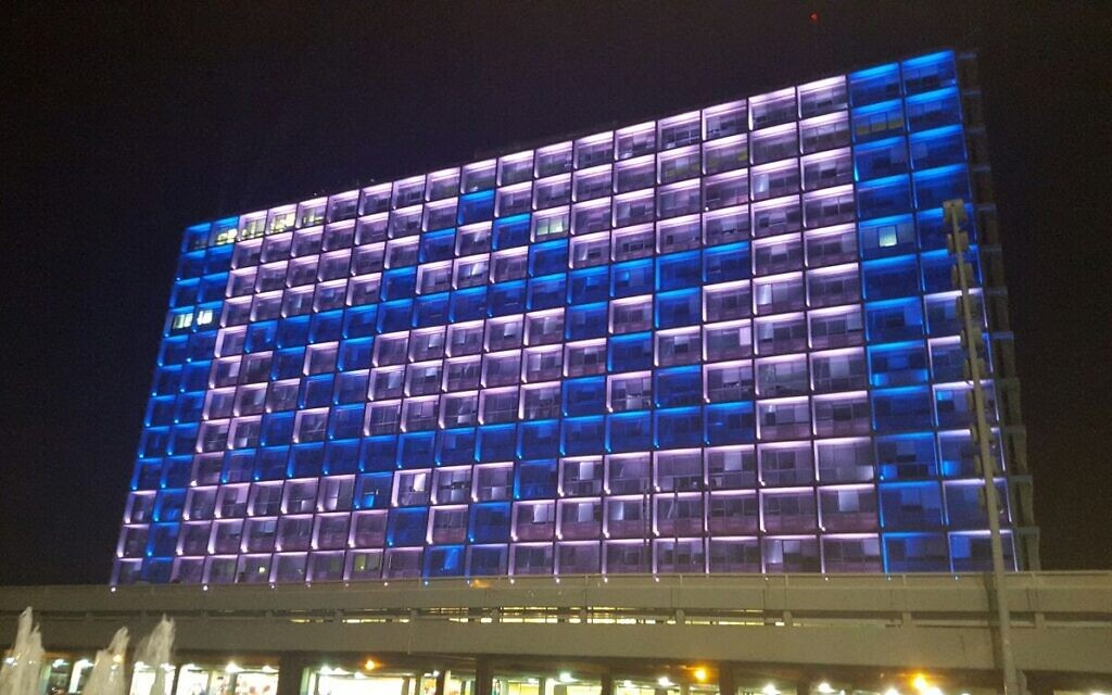 Tel Aviv's City Hall will be lit up for this year's Yom Ha'atzmaut celebration on April 28, 2020, which will eschew fireworks and parades for a more modest festivities in honor of Israel's 72nd year of independence. (courtesy, City of Tel Aviv-Jaffa)