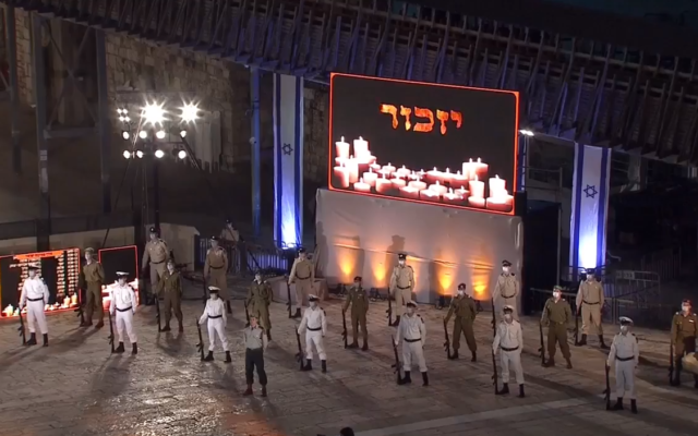 Soldiers wearing masks stand at attention  at the national opening ceremony for Israel's Memorial Day for fallen soldiers and victims of terror, at the Western Wall in Jerusalem, April 27, 2020, (video screenshot)