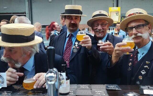 Belgian drinkers enjoying their glasses of Ginger Tipple, a kosher for Passover beer (Courtesy Ginger Tipple)
