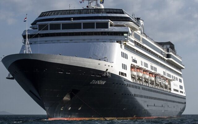 View of Holland America's cruise ship Zaandam as it entered the Panama City bay to be assisted by the Rotterdam cruise ship with supplies, personnel and COVID-19 testing devices, eight miles off the coast of Panama City, on March 27, 2020. (Photo by Ivan PISARENKO / AFP)