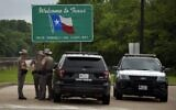 Texas State troopers patrol I-10 across the border from Louisiana on March 30, 2020 in Orange, Texas (Mark Felix / AFP)