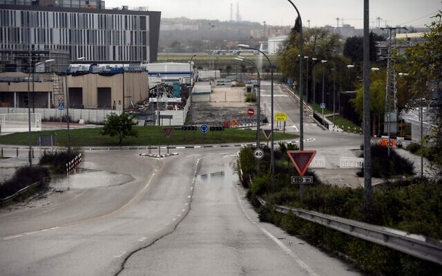 The empty access road of an industrial park in Madrid on March 31, 2020, during a national lockdown to prevent the spread of the novel coronavirus. (Photo by OSCAR DEL POZO / AFP)