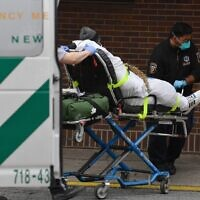 Paramedics push a gurney with a patient to the Brooklyn Hospital Center Emergency Room in New York on March 31, 2020. (Angela Weiss/AFP)
