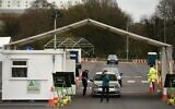 NHS workers are swabbed at a drive-in facility to test for the novel coronavirus COVID-19, set up in the car park on the outskirts of Manchester on April 4, 2020. (Oli SCARFF / AFP)