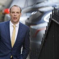 Britain's Foreign Secretary Dominic Raab arrives at Downing Street in central London to chair the government's Covid-19 daily briefing on April 7, 2020. (Tolga AKMEN / AFP)
