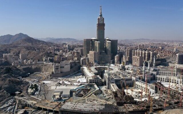 An aerial view shows the Great Mosque and the Mecca Tower and the deserted surroundings in the Saudi holy city of Mecca on April 8, 2020, during the novel coronavirus pandemic crisis. (BANDAR ALDANDANI / AFP)