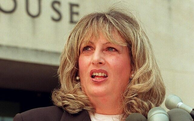 In this file photo taken on July 29, 1998 Linda Tripp talks to reporters outside of the Federal Courthouse in Washington, DC, following her eighth day of testimony before the grand jury investigating the Monica Lewinsky affair (WILLIAM PHILPOTT / AFP)