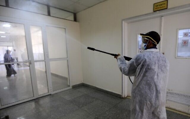 A man sprays disinfectant at the Central Health Laboratory in the Yemeni capital Sanaa, amid the novel coronavirus pandemic, on April 11, 2020. (MOHAMMED HUWAIS / AFP)