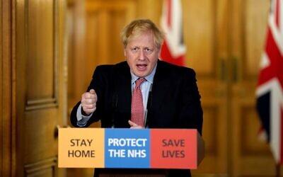 In this file photo taken on March 25, 2020 Britain's Prime Minister Boris Johnson speaks during a remote press conference to update the nation on the Covid-19 pandemic at 10 Downing Street in central London on March 25, 2020. (10 Downing Street / AFP)