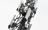 A 5G mast erected by telecom operator 'Proximus' that was set on fire, in Peltheide, Limburg province, Belgium, April 19, 2020.  (YORICK JANSENS / Belga / AFP)