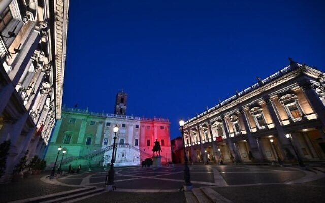 The colors of the Italian flag are projected onto the Palazzo Senatorio building on Capitoline Hill (Campidoglio) in Rome, on April 26, 2020 during the country's lockdown aimed at curbing the spread of the COVID-19 infection.(Photo by ANDREAS SOLARO / AFP)
