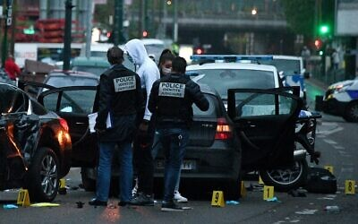 French police officers check the site where a driver injured two policemen on April 27, 2020, in Colombes (FRANCK FIFE / AFP)