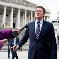 US Rep. Thomas Massie, a Kentucky Republican, stops to speak with reporters as he leaves the Capitol after the coronavirus stimulus was passed in the House, March 27, 2020. (Bill Clark/CQ-Roll Call, Inc via Getty Images via JTA)