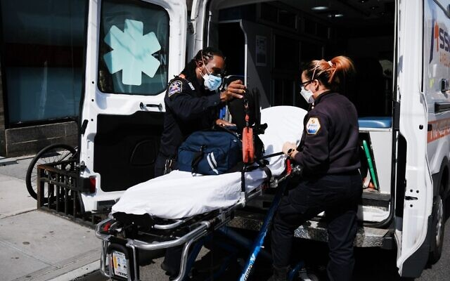 Ambulance workers clean a gurney at Mount Sinai Hospital amid the coronavirus pandemic in New York City,  on April 1, 2020. (Spencer Platt/Getty Images/AFP)