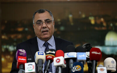 Palestinian Authority government spokesman Ibrahim Milhim speaks at a press conference in Ramallah on April 1, 2020. (Wafa)