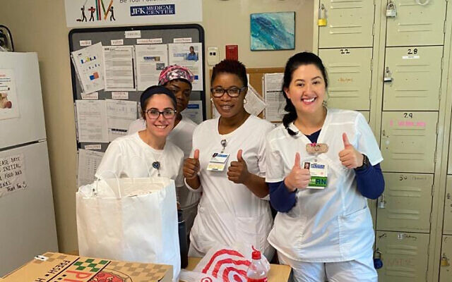 Illustrative: Observant health care workers and their colleagues receive kosher meals provided by a coronvirus initiative launched by Bethany Mandel. (Courtesy of Mandel/ via JTA)