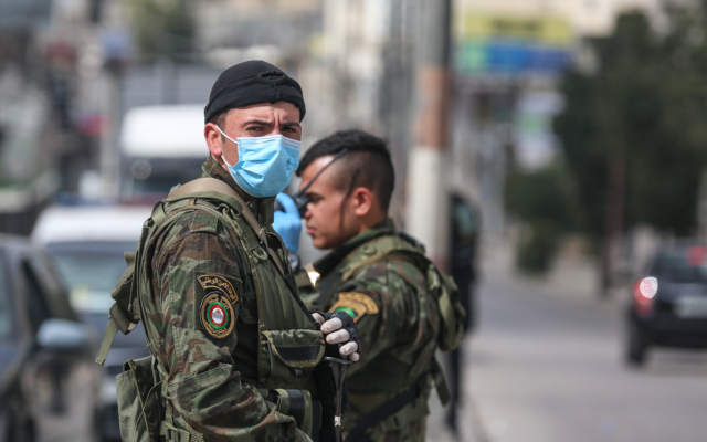 Members of the Palestinian Authority security forces patrolling in the village of Beitunia in the central West Bank on April 6, 2020. (Credit: Wafa)