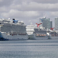 Cruise ships are docked at PortMiami on March 31, 2020, in Miami. (AP Photo/Wilfredo Lee)