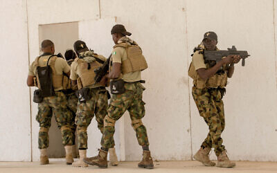 In this February 18, 2020, file photo, Nigerian Navy Special Boat Service troops exercise under the supervision of British special forces during US military-led annual counterterrorism exercise in Thies, Senegal. (AP Photo/Cheikh A.T. Sy, File)