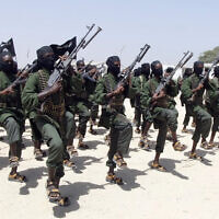 Hundreds of newly trained al-Shabab fighters perform military exercises in the Lafofe area south of Mogadishu, in Somalia, February 17, 2011. (AP Photo/Farah Abdi Warsameh, File)
