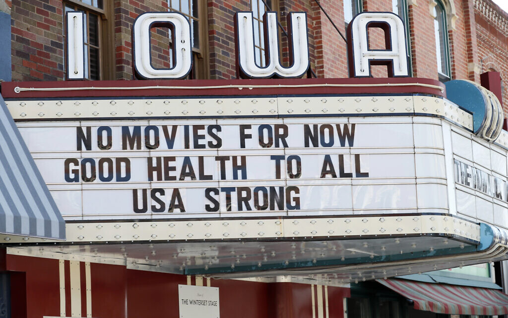 The marquee for the Iowa Theater, closed in response to the coronavirus outbreak, is seen on John Wayne Drive, Wednesday, April 1, 2020, in Winterset, Iowa.(AP Photo/Charlie Neibergall)