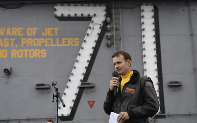 In this Nov. 15, 2029, photo US Navy Capt. Brett Crozier, commanding officer of the aircraft carrier USS Theodore Roosevelt (CVN 71), addresses the crew during an all-hands call on the ship's flight deck while conducting routine operations in the Eastern Pacific Ocean.  (US Navy Photo by Mass Communication Specialist 3rd Class Nicholas Huynh via AP)