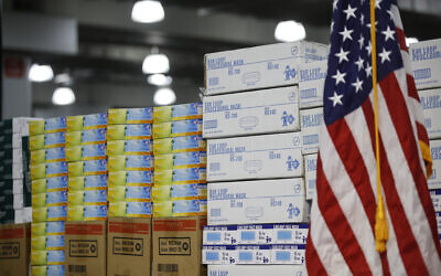 In this March 24, 2020, file photo stacks of medical supplies are housed at the Jacob Javits Center that will become a temporary hospital in response to the COVID-19 outbreak in New York. A review of federal purchasing contracts by The Associated Press shows federal agencies waited until mid-March to begin placing bulk orders of N95 respirator masks, mechanical ventilators and other equipment needed by front-line health care workers. (AP Photo/John Minchillo, File)