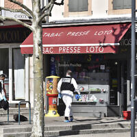 In this April 4, 2020 file photo, police officers investigate after a man wielding a knife attacked residents venturing out to shop in the town under lockdown, in Romans-sur-Isere, southern France. French counter-terrorism prosecutors have opened a judicial investigation for murders and attempted murders in relation with a terrorist undertaking, four days after a knife attack south of Lyon left two people dead. (AP Photo)