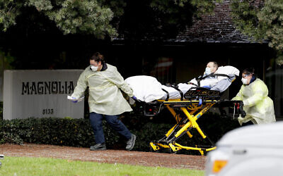 Illustrative: A patient is evacuated from the Magnolia Rehabilitation and Nursing Center in Riverside, California, April 8, 2020. (Chris Carlson/AP)