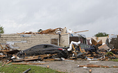 A home had its roof torn off after a tornado ripped through Monroe, La. just before noon on Sunday, April 12, 2020 causing damage to a neighborhood and the regional airport. (Nicolas Galindo/The News-Star via AP)
