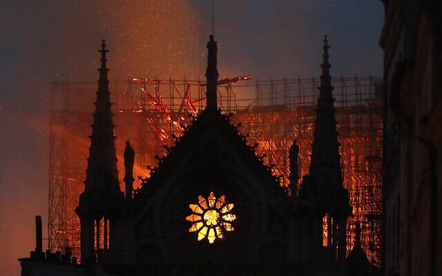 In this April 15, 2019, file photo, flames and smoke rise from Notre Dame Cathedral as it burns in Paris. (AP Photo/Thibault Camus, File)