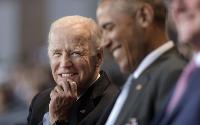 In this Jan. 4, 2017 file photo, US Vice President Joe Biden, left, watches US President Barack Obama, center, at Conmy Hall, Joint Base Myer-Henderson Hall, Va. (AP Photo/Susan Walsh)