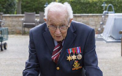 Tom Moore, a 99-year-old British veteran who has started a campaign to thank the National Health Service by walking lengths in his garden.(Moore Family via AP)