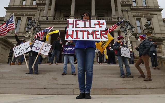 Dawn Perreca protests on the front steps of the Michigan State Capitol building in Lansing, Michigan, April 15, 2020 (AP Photo/Paul Sancya)