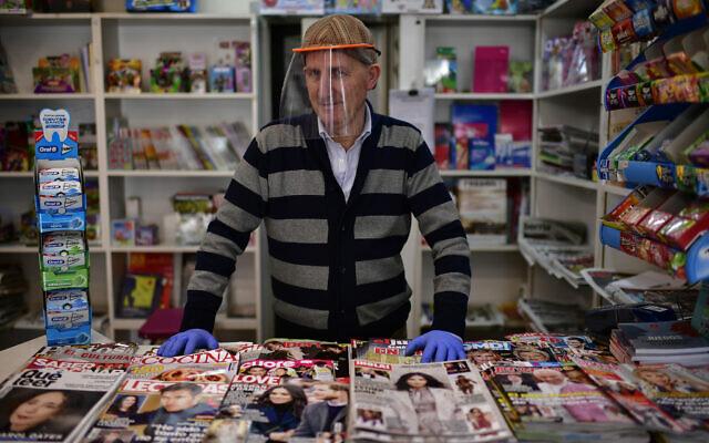Antonio Leoz in his book shop in Pamplona, northern Spain, April 14, 2020. (AP Photo/Alvaro Barrientos)
