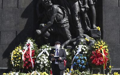 Poland's chief rabbi, Michael Schudrich, says prayers before the monument to the heroes of the 1943 Warsaw Ghetto Uprising in Warsaw, Poland, April 19, 2020. (Czarek Sokolowski/AP)