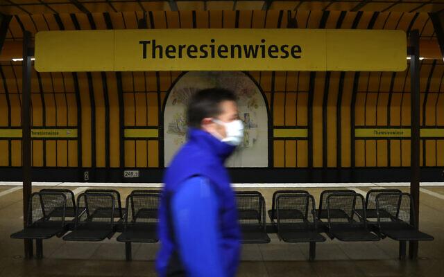 A man wearing a face mask in Munich, Germany, April 21, 2020. (AP Photo/Matthias Schrader)