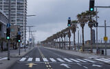 Illustrative: In this April 11, 2020, photo, Tel Aviv's beachfront promenade and a main road are empty of people during a lockdown following government measures to help stop the spread of the coronavirus in Tel Aviv. (AP Photo/Oded Balilty)