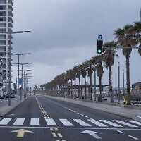 In this April 11, 2020, photo, Tel Aviv's beachfront promenade and a main road are empty of people during a lockdown following government measures to help stop the spread of the coronavirus in Tel Aviv. (AP Photo/Oded Balilty)