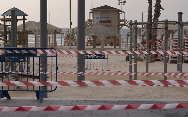 Tel Aviv's beachfront is wrapped in police tape to prevent public access during a lockdown following government measures to help stop the spread of the coronavirus, March 30, 2020. (AP Photo/Oded Balilty)