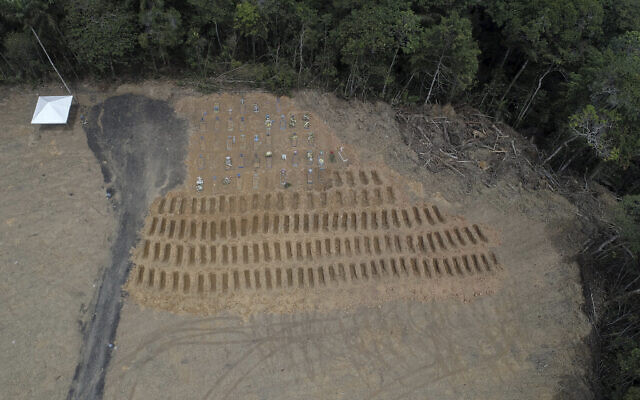 Freshly dug graves are seen at the Nossa Senhora Aparecida cemetery, amid the new coronavirus pandemic in Manaus, Amazonas state, Brazil, Wednesday, April 22, 2020. (AP/Emerson Cardoso)