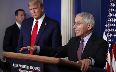 US President Donald Trump (L) listens as Dr. Anthony Fauci, director of the National Institute of Allergy and Infectious Diseases, speaks about the coronavirus in the James Brady Press Briefing Room of the White House on April 22, 2020, in Washington. (AP/Alex Brandon)