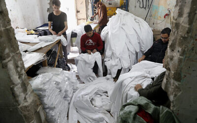 In this Monday, March 30, 2020 file photo, Palestinians make protective overalls meant to shield people from the coronavirus, to be exported to Israel, at a local factory in Gaza City (AP Photo/Adel Hana, File)