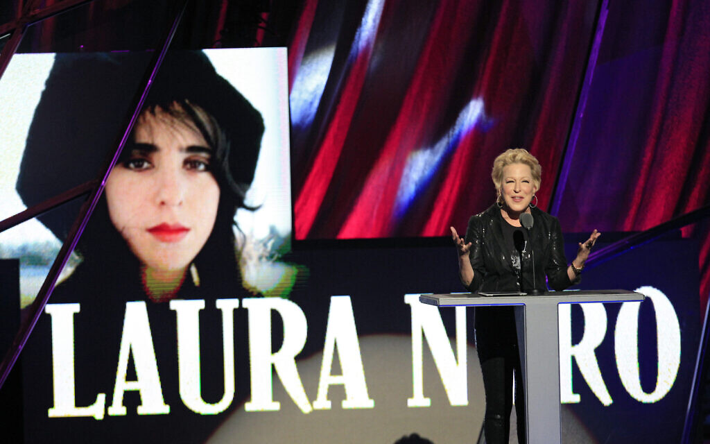 Bette Midler presents the late Laura Nyro for induction into the Rock and Roll Hall of Fame Saturday, April 14, 2012, in Cleveland. (AP Photo/Tony Dejak)