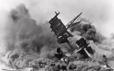 In this Dec. 7, 1941 file photo, smoke rises from the battleship USS Arizona as it sinks during a Japanese surprise attack on Pearl Harbor, Hawaii. (AP File Photo)