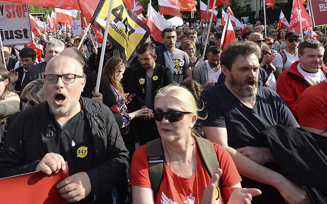 Thousands of Polish nationalists march to the US Embassy, in Warsaw, Poland, May 11, 2019, to protest against pressure from Washington to compensate Jews whose families lost property during the Holocaust. (AP Photo/Czarek Sokolowski)