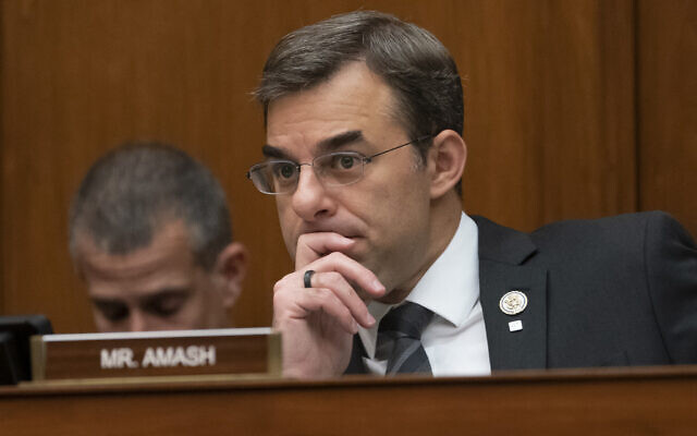 Rep. Justin Amash, R-Mich., listens to debate as the House Oversight and Reform Committee considers whether to hold Attorney General William Barr and Commerce Secretary Wilbur Ross in contempt for failing to turn over subpoenaed documents related to the Trump administration's decision to add a citizenship question to the 2020 census, on Capitol Hill in Washington, Wednesday, June 12, 2019. Rep. Amash is the only Republican in the House to call for President Donald Trump's impeachment. (AP Photo/J. Scott Applewhite)