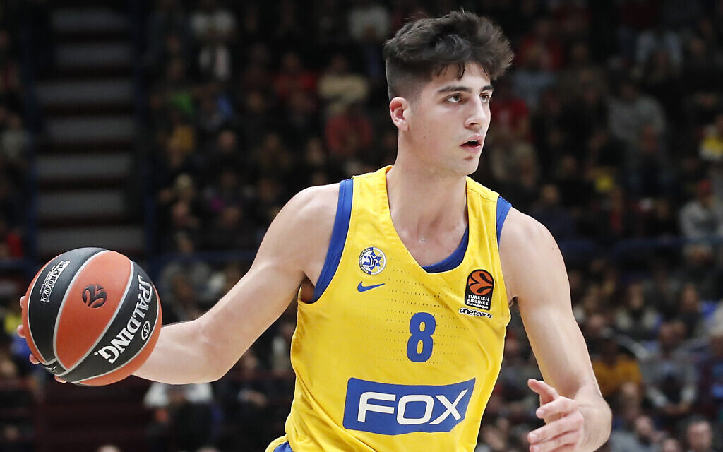 Maccabi Tel Aviv's Deni Avdija controls the ball during the Euro League basketball match between Olimpia Milan and Maccabi Fox Tel Aviv, in Milan, Italy, November 19, 2019. (AP Photo/Antonio Calanni)